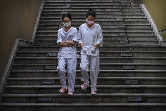 Women on a break at a shopping mall in Beijing.