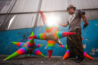 A pinata maker in Mexico City, the epicentre of the nation's outbreak.