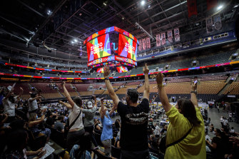 Vaccine recipients at Scotiabank Arena, Toronto, cheer for giveaways as the number of doses administered reaches 25,000. The venue went on to set a North American record of 26,771 jabs in a day.