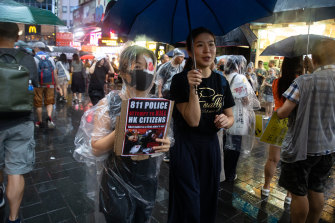 A demonstrator holds a sign during the peaceful protest on Sunday in Hong Kong.