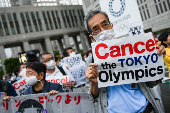 A protest against the Olympics in Tokyo, where the government is trying to live with COVID-19.