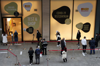 Test & Shop: People form a socially distanced queue at a COVID-19 test centre before being allowed in the Mall of Berlin, in Germany, on Friday.
