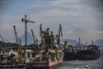 A tugboat pulls a Petrobras oil tanker in the Guanabara Bay in Rio earlier this month.