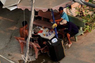 With a portable speaker in tow, locals assemble for karaoke in Ho Chi Minh City on Sunday.