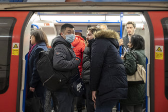 A passenger wears a protective face mask on the London Underground.