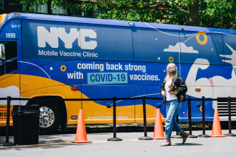 A pedestrian walks by a mobile Covid-19 vaccine clinic at Brighton Beach, Brooklyn, New York.