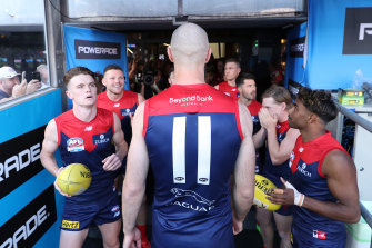 Max Gawn leads the Dees onto the field.