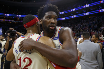 Joel Embiid hugs Tobias Harris after the 76ers' win.