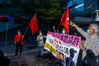 Pro-Beijing supporters outside the legislature's building in Hong Kong on Wednesday.