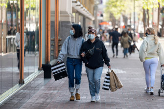 Shoppers on Market Street in San Francisco. The population of California has dropped for the first time in history.