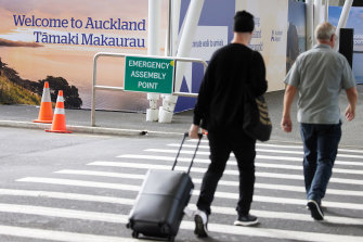 Travelers at Auckland International Airport.