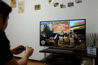 Three friends each received a $1652 fine - a total penalty of almost $5000 - for playing video games in a lounge room.