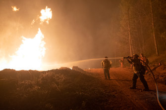Firefighters try to douse flames in Oroville, California, US.