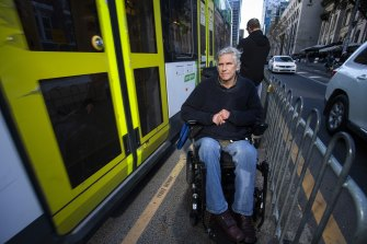 Martin Leckey is suing the state government and Yarra Trams over delays in making tram infrastructure accessible.