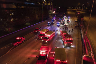 Emergency workers at the site of the incident on the Interstate 5 in Seattle.