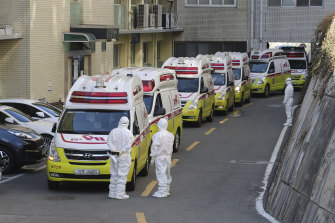 Ambulances carrying coronavirus patients arrive at a hospital in Daegu, South Korea on Sunday.