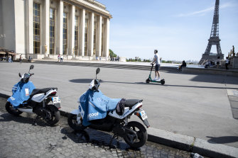 A pair of Pariscoot public hire electric scooters stand near the Eiffel Tower in Paris. Huge stimulus packages in Europe are likely to help countries recover from the coronavirus pandemic.