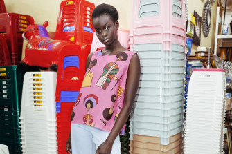 A model wear Obus clothing featuring designs based on the work of Ethiopian-born painter Olana Janfa.