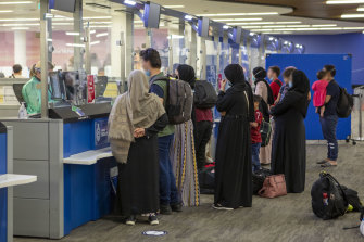 People arrive in Australia from Afghanistan last month.