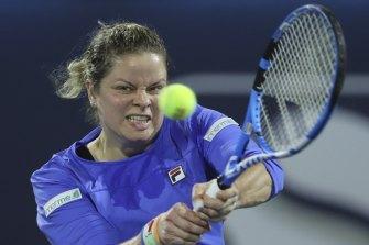 Belgium's Kim Clijsters returns the ball to Spain's Gabrine Muguruza in Dubai.