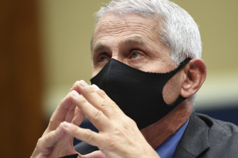 Dr Anthony Fauciwears a face mask as he waits to testify in Washington.