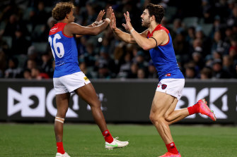 Kysaiah Pickett and Christian Petracca celebrate a goal.