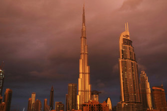 Sunlight reflects off the Burj Khalifa, the world's tallest building, during a rain shower in Dubai in 2018.