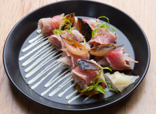 Tuna tataki - scrolled furls of flame-touched fish sitting over onions and wasabi cream.