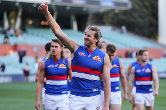 Marcus Bontempelli and his teammates leave the field after their win over Hawthorn.