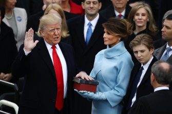 Donald Trump takes the oath of office as his wife Melania Trump, looks on during the presidential inauguration in January 2017.