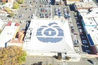 Woolworths' solar panels on a supermarket roof in Orange, NSW.
