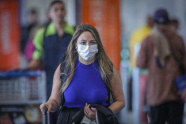 A traveler wears a protect mask while walking through the Juscelino Kubitschek International Airport in Brasilia, Brazil, on Wednesday, March 11, 2020. TheWorld Health Organizationwas too slow in declaring the globalcoronavirusoutbreak a pandemic, complicating authorities' work to curb the spread of the virus, according to Brazil's Health MinisterLuiz Henrique Mandetta. Photographer: Andre Coelho/Bloomberg