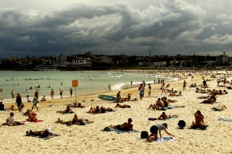 Storm rolls into Sydney as sun lovers soak up the last sun rays at Bondi Beach.