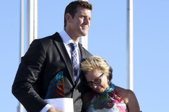 Rosie Batty, having just been announced as 2015 Australian of the Year, is comforted by Ben Roberts-Smith, Chair of the National Australia Day Council.