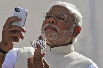 Modi takes a selfie with his party's lotus symbol before his election win in 2014.