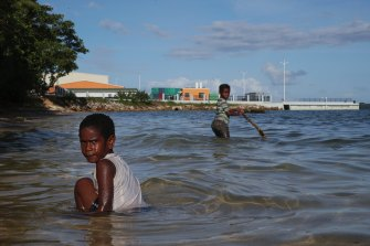 Children play near a new wharf in Luganville, Vanuatu.