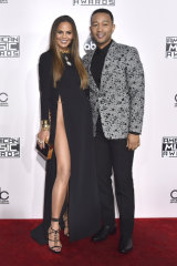 Chrissy Teigen (with husband John Legend) wearing a Yousef Akbar design to the American Music Awards in 2016.