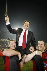 A long time coming: Thorn, left, helps hold aloft Crusaders coach Robbie Deans after their Super 14 final victory over the Waratahs in 2008.