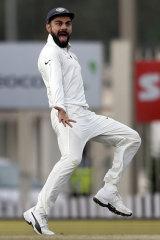 Virat Kohli gestures to Australia's Matt Renshaw after the dismissal of David Warner last year in India.