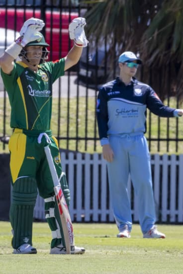 David Warner calls for new gloves while Steve Smith directs traffic in the field.