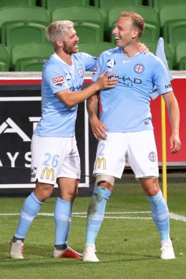 Luke Brattan congratulates De Laet on his goal.