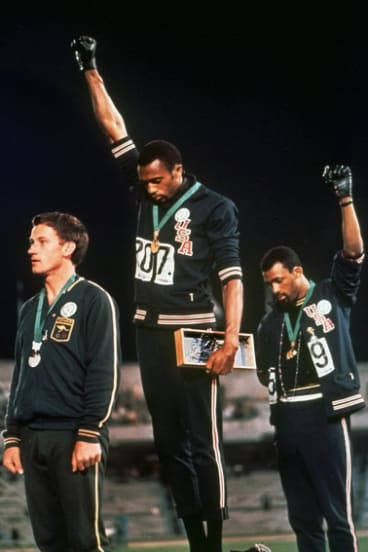 The iconic photo of Peter Norman, left, with Tommie Smith and John Carlos.