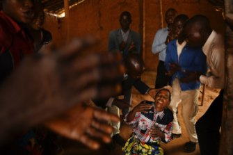 A religious group performs an exorcism on a woman in small church in Tshimbulu village. More than 70 percent of the population attend religious service weekly. Exorcisms occur frequently.