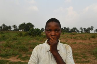 Former child soldier Olivier at a farm that is run by a local organisation helping teenagers and young men, including former militia members to learn a trade.