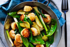 Kylie Kwong's Stir-fried scallops with snow peas and ginger / Stir-fried asparagus with garlic. Recipe for Good Food Photos:?William?Meppem Styling: Hannah?Meppem