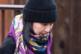 Former Huawei Australia director Meng Wanzhou leaves her home in Canada.