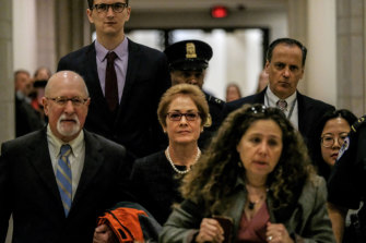 Marie Yovanovitch, the former US Ambassador to Ukraine, centre, arrives at the US Capitol in Washington DC.