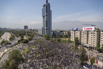 Demonstrators are seen in an aerial photograph taken above Plaza Italia during a protest in Santiago.