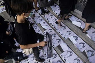 Students step on posters featuring Hong Kong Chief Executive Carrie Lam during a protest ahead of a graduation ceremony at the Chinese University of Hong Kong (CUHK) on Thursday.