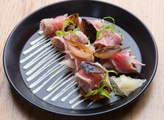 Tuna tataki - scrolled furls of flame-touched fish sitting over onions and wasabi cream.